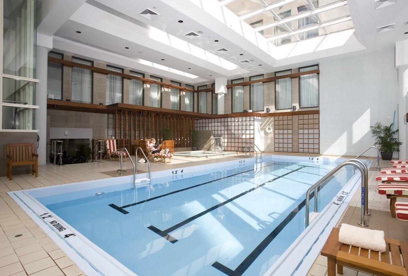 Hotels indoor swimming pool property room ceiling floor leisure centre condominium Architecture estate interior design daylighting counter Lobby Design headquarters mansion Deck