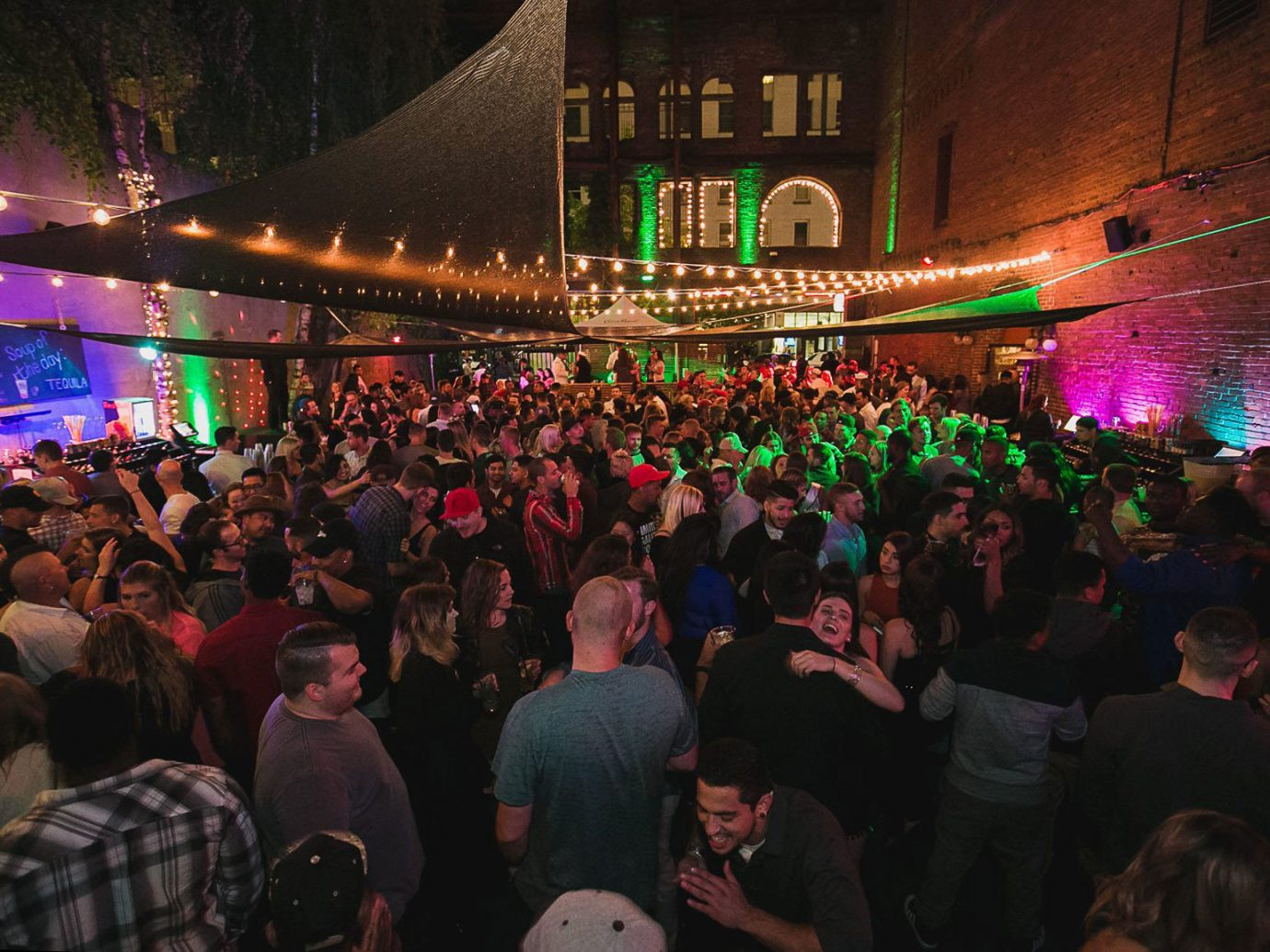 Arts + Culture person crowd people audience night nightclub Bar