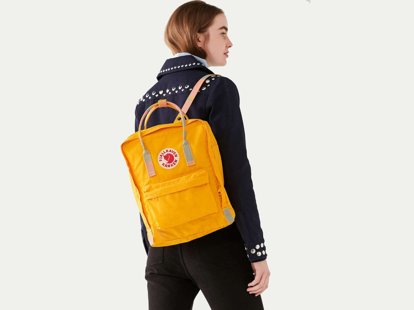Travel Shop person yellow bag shoulder jacket outerwear product sleeve joint neck