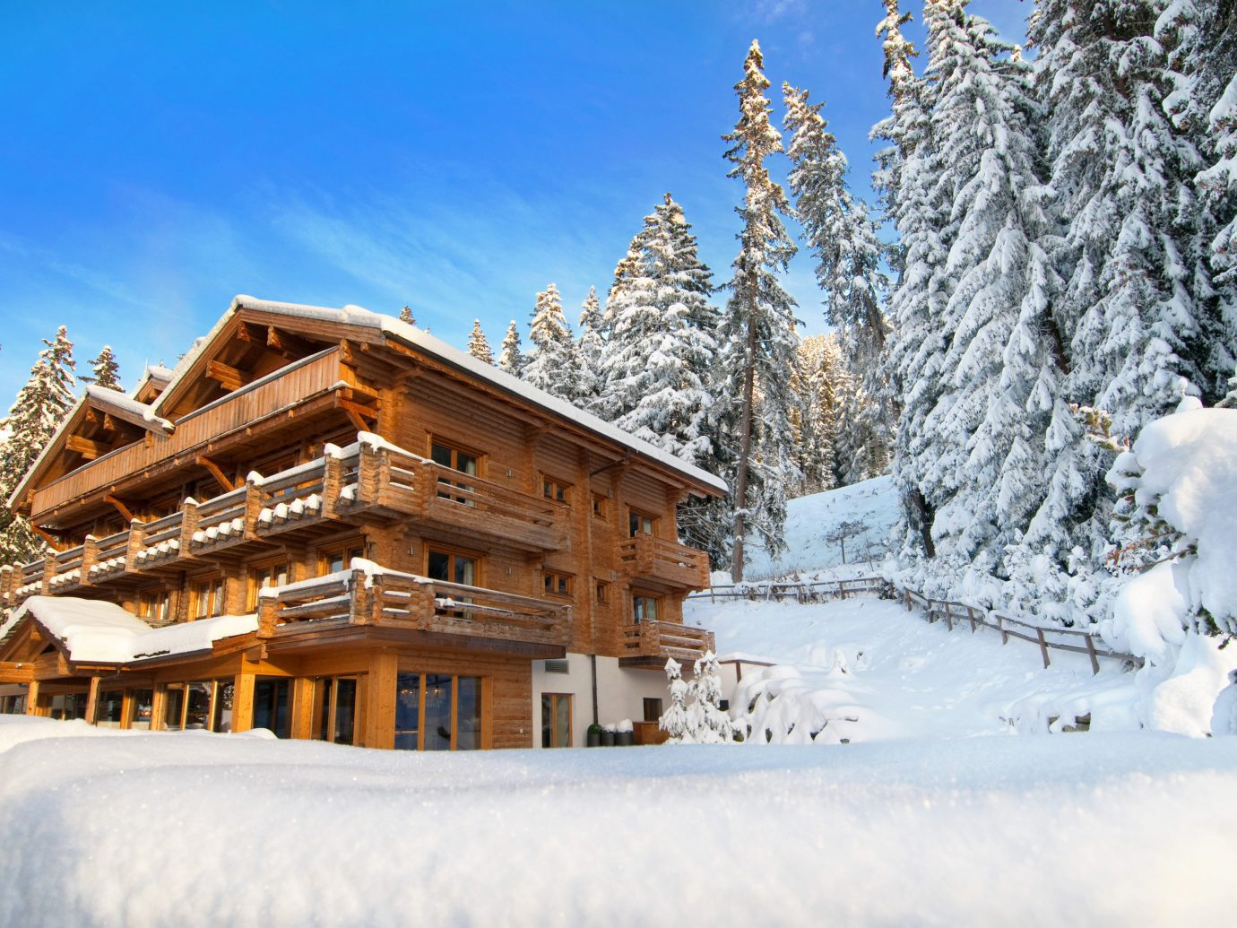 Hotels Luxury Travel Mountains + Skiing outdoor snow tree sky Winter weather season geological phenomenon Resort Nature mountain mountain range