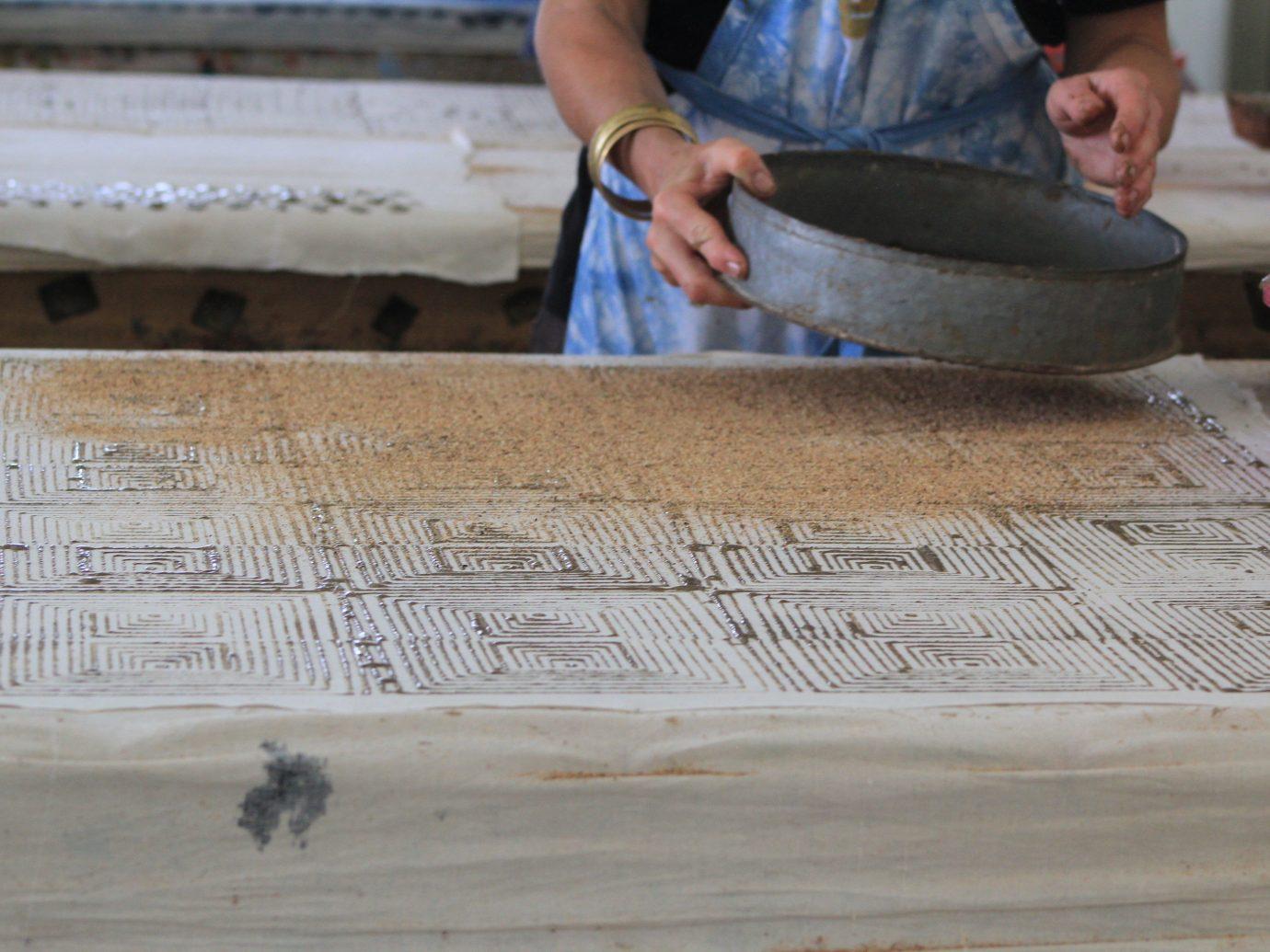 Health + Wellness Scuba Diving + Snorkeling Trip Ideas person wood art carving temple material flooring