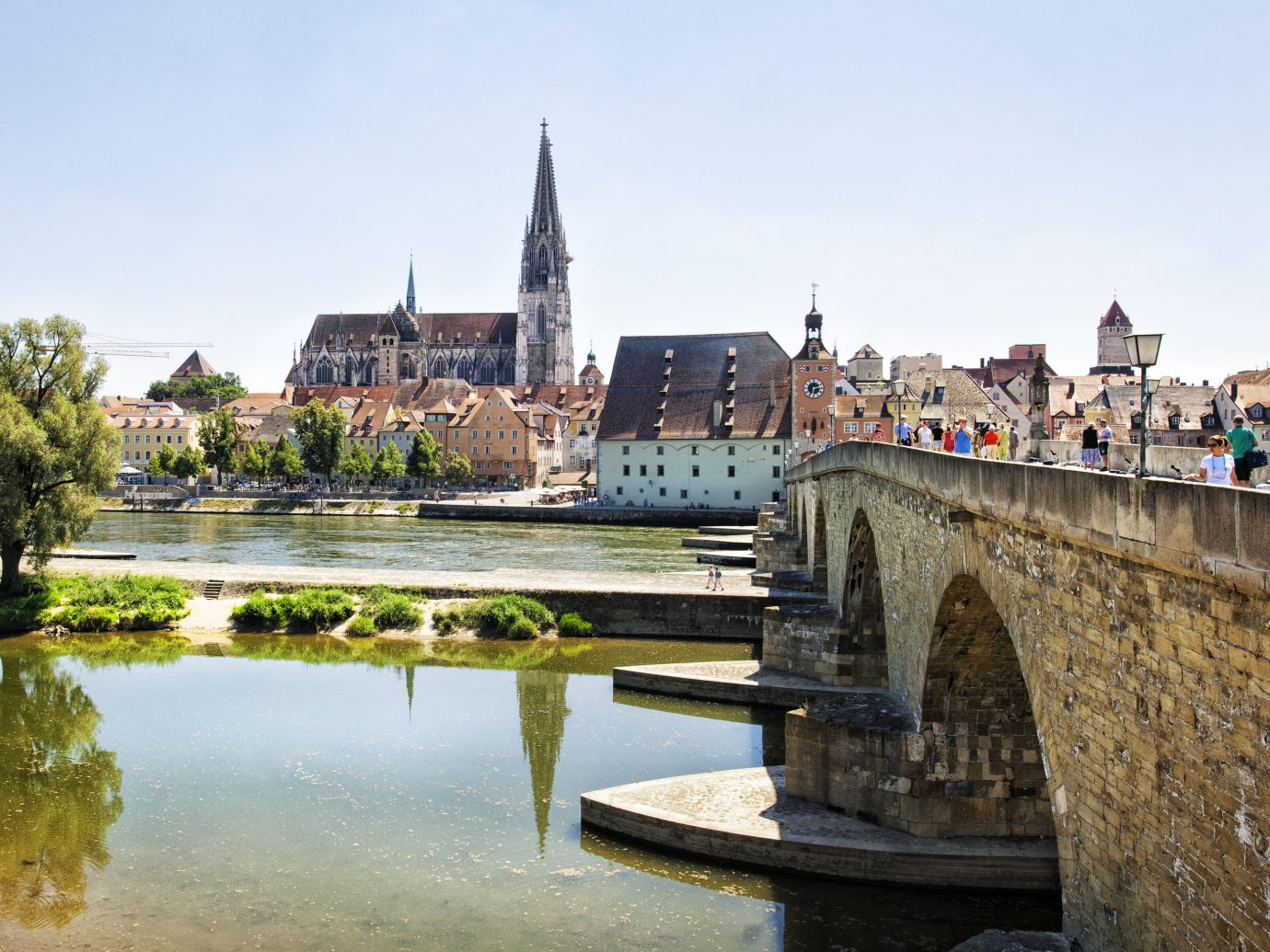 Lakes + Rivers Landmarks Travel Tips sky outdoor water bridge River landmark Town City tourism reflection vacation waterway château cityscape Canal tours travel park stone traveling castle passing