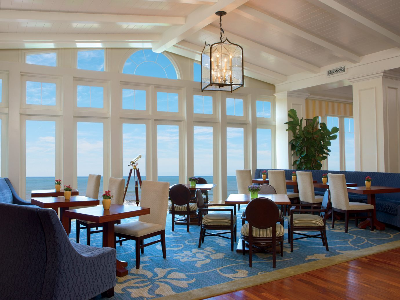 Bar Dining Drink Eat Hotels Scenic views indoor floor room window chair wall ceiling property Living dining room conference hall estate interior design home real estate restaurant function hall Design Lobby living room Resort window covering furniture area several