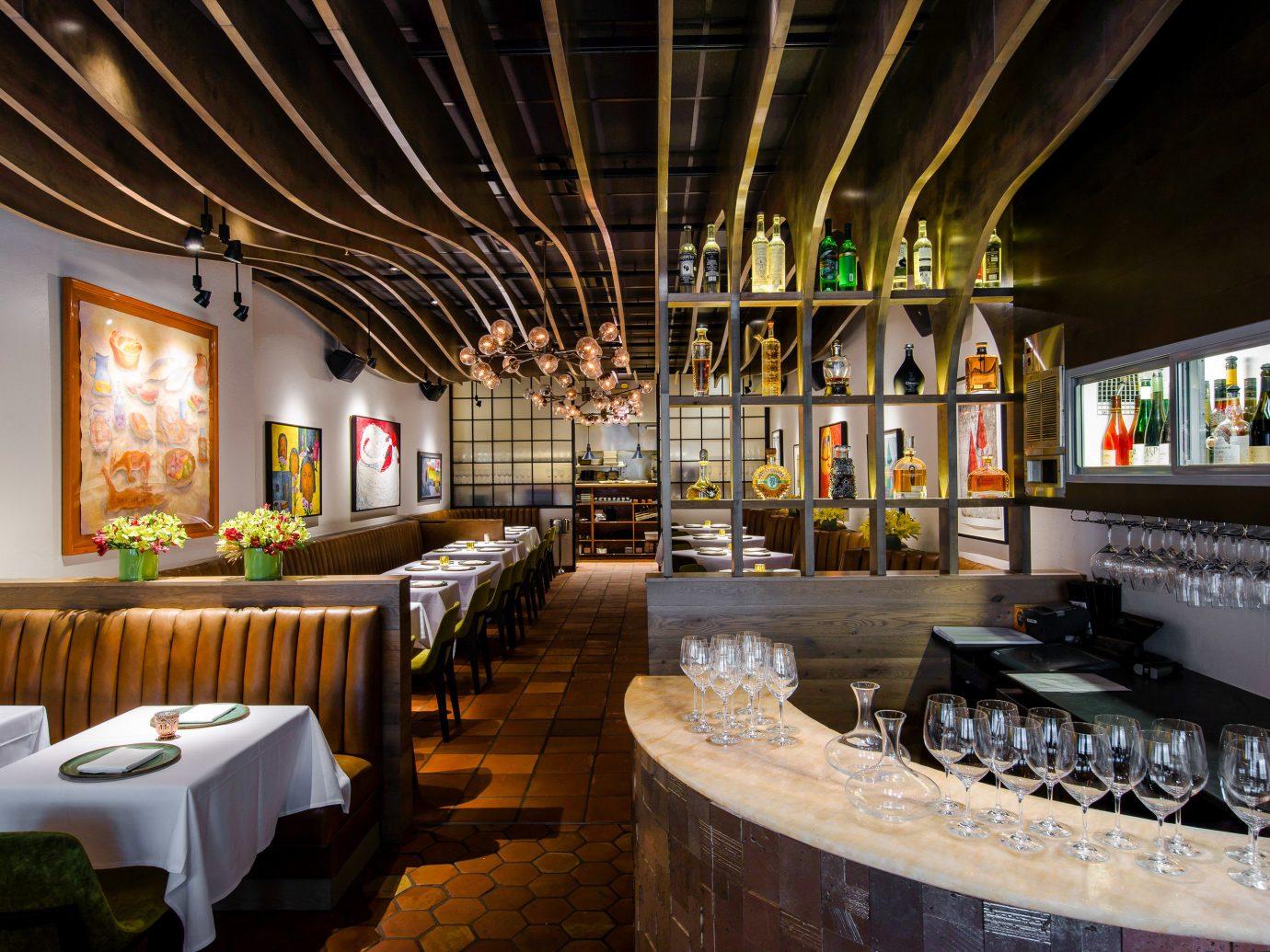 Food + Drink indoor interior design restaurant ceiling table furniture