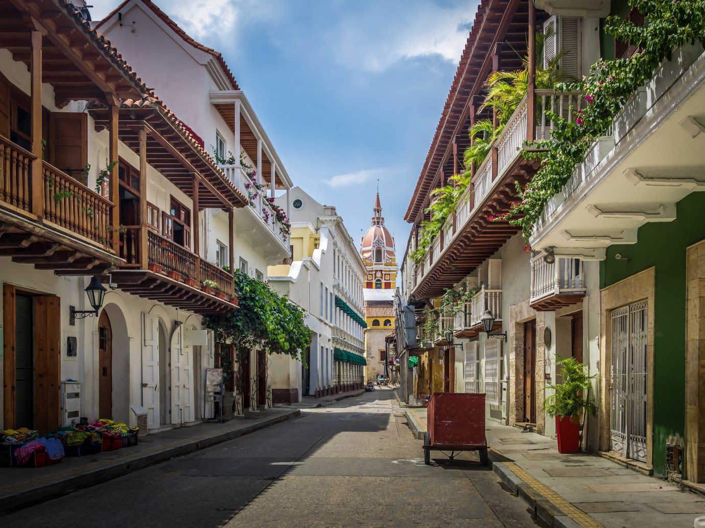 Offbeat Travel Tips building outdoor sky way scene Town neighbourhood sidewalk street road infrastructure residential area City house alley tree lane home real estate facade narrow mixed use Downtown window apartment residential stone