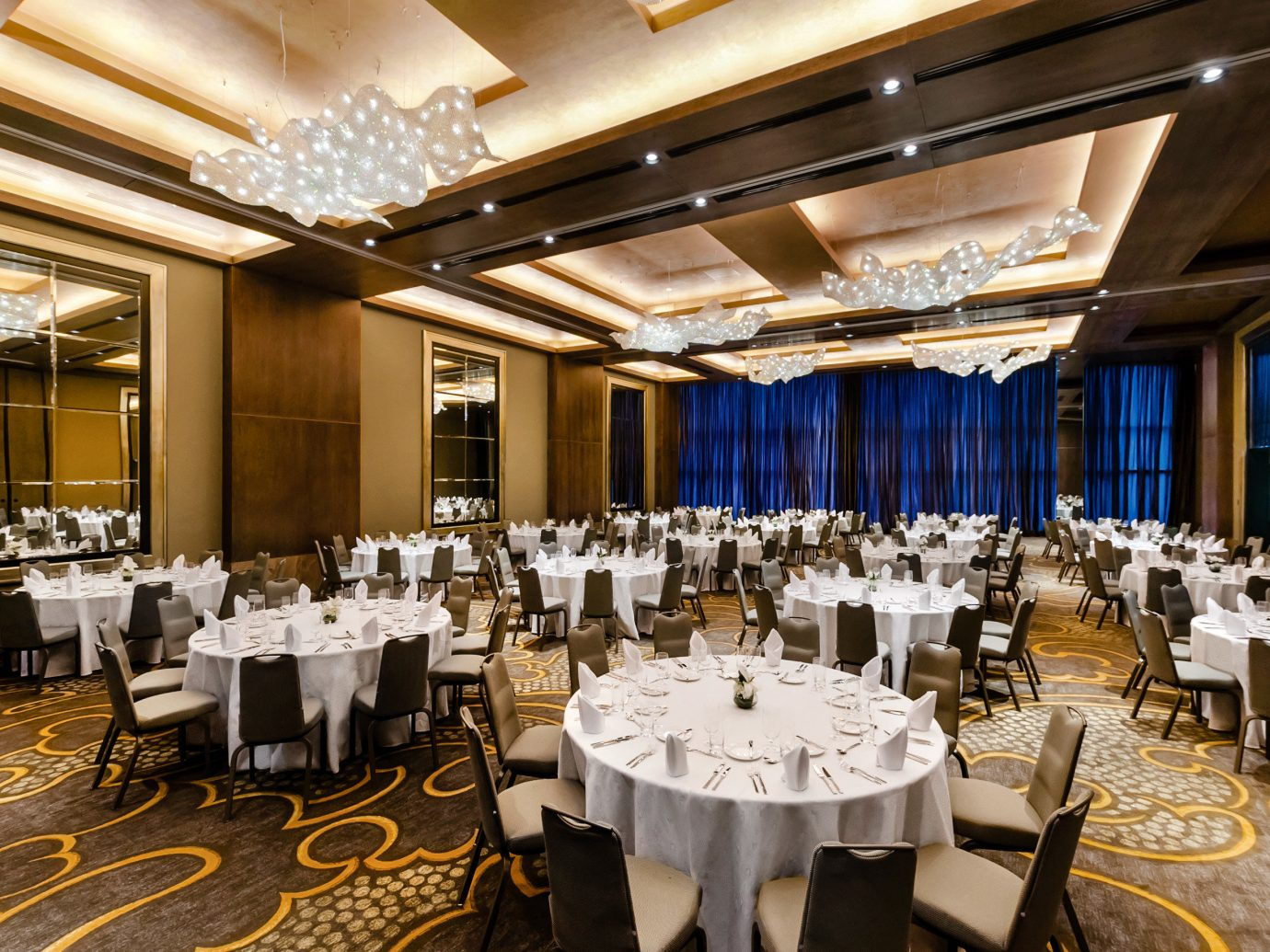 Boutique Hotels Hotels table indoor ceiling floor function hall Dining restaurant ballroom banquet conference hall interior design ceremony wedding reception dining room fancy room several furniture meal dining table