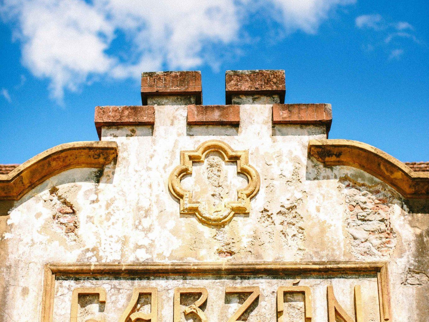 Beach Romantic Getaways south america Trip Ideas Uruguay sky landmark arch wall building cloud facade history historic site ancient history stock photography tourism