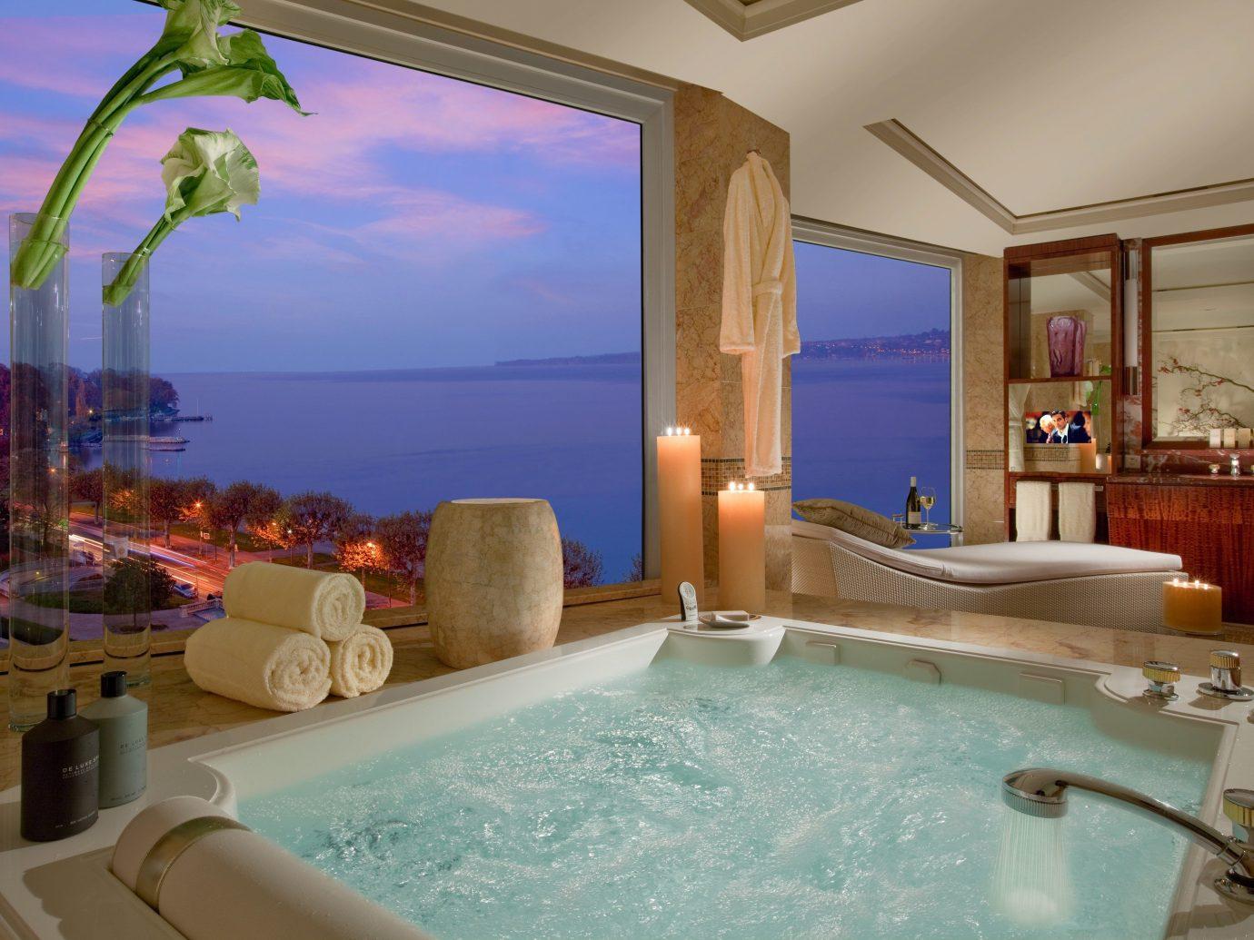 Hotels Luxury Travel indoor swimming pool room property vessel bathtub estate Suite jacuzzi Villa mansion interior design condominium real estate Resort Bath tub furniture