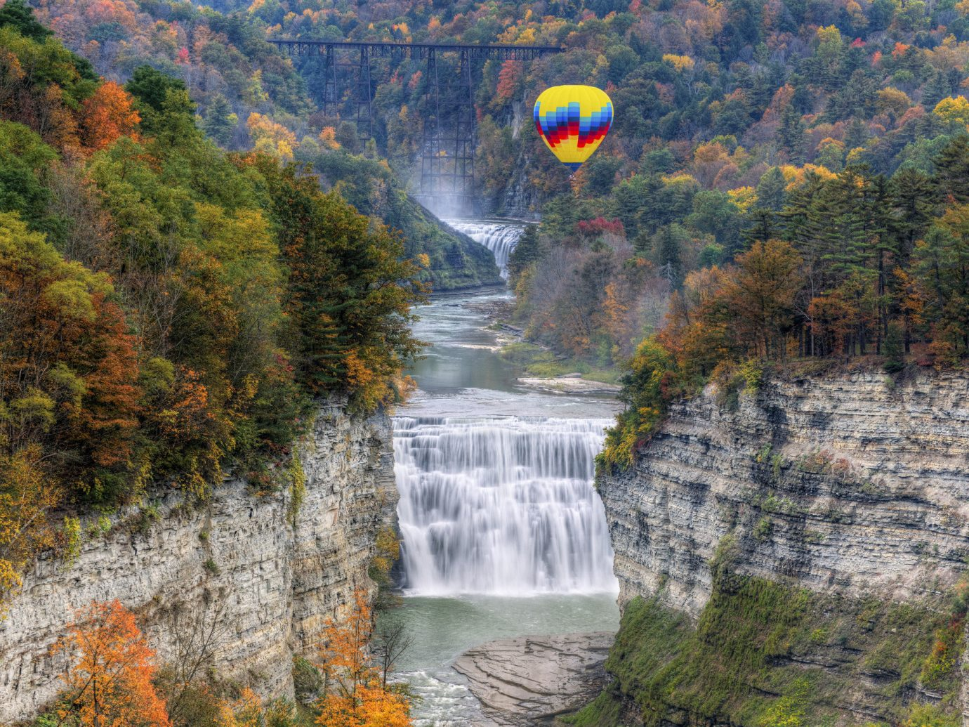 Secret Getaways Trip Ideas Weekend Getaways tree outdoor Nature water leaf body of water Waterfall autumn nature reserve River water feature watercourse national park biome landscape escarpment rock Lake Forest plant mountain water resources state park chute stream wooded colored