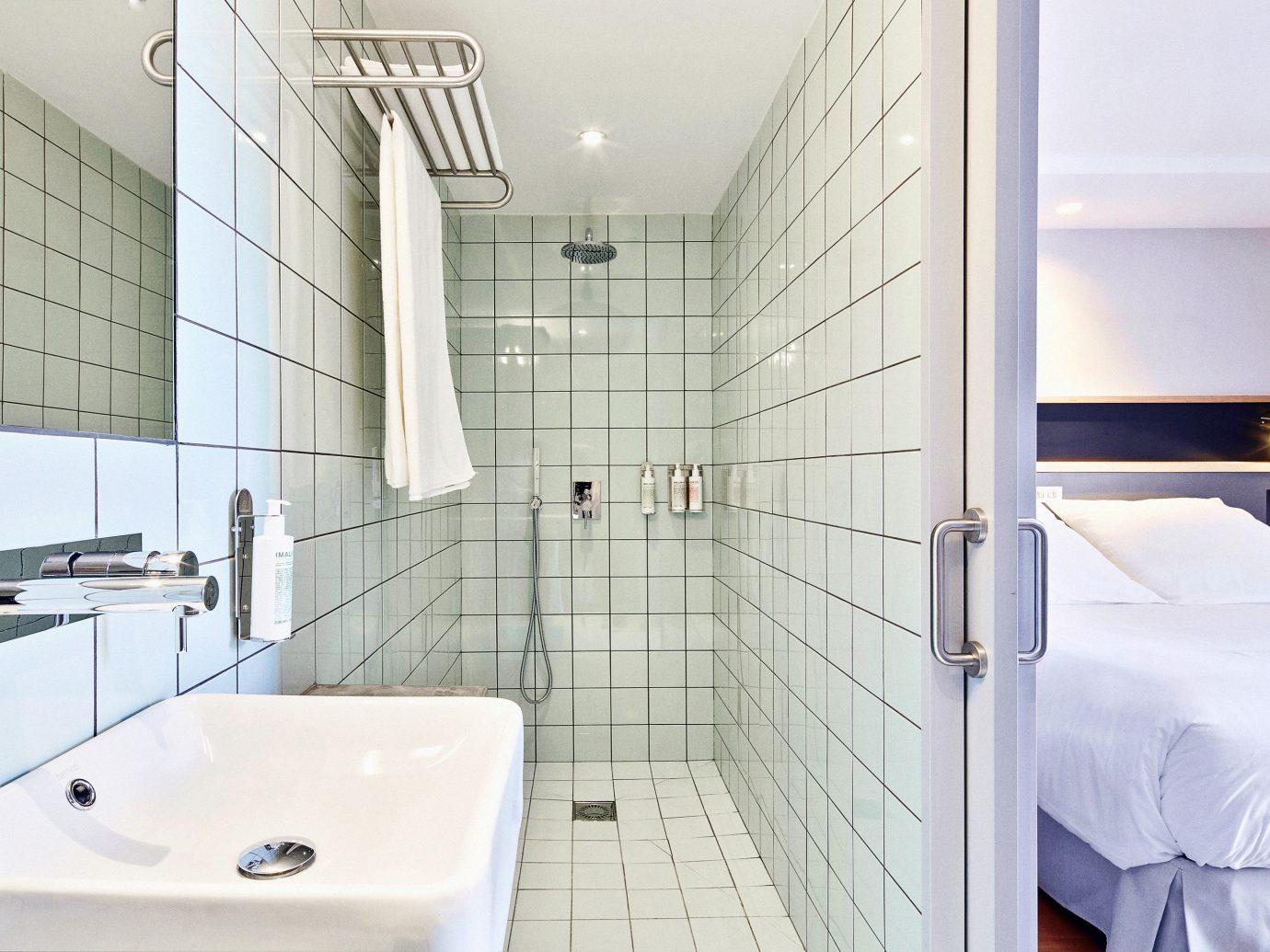 Barcelona Hotels Spain indoor bathroom room property interior design floor tile real estate tap product design plumbing fixture flooring daylighting angle Suite estate interior designer toilet tiled