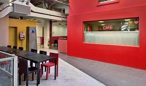 Jetsetter Guides floor indoor property red interior design real estate restaurant table