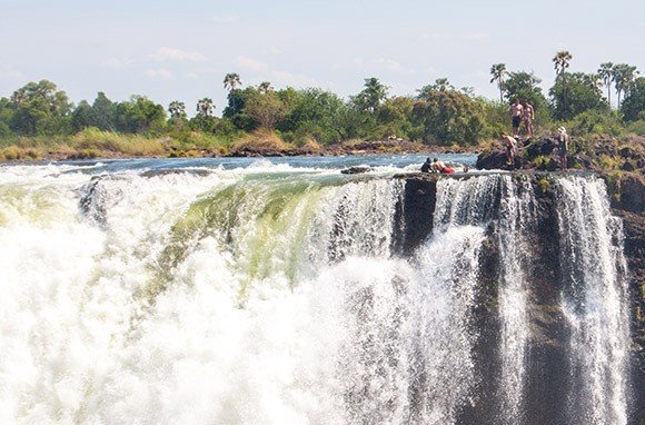 Trip Ideas outdoor sky water tree Nature Waterfall body of water River rapid water feature wave waterway boating