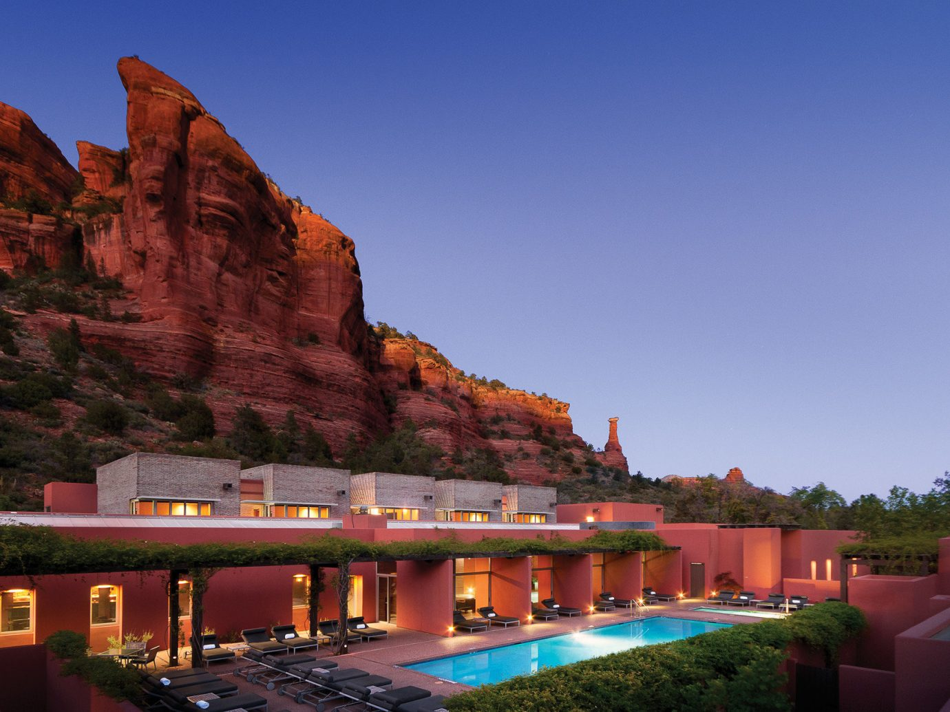 ambient lighting building Exterior golden hour Greenery isolation lounge chairs Luxury Mountains outdoor pool Pool relaxation remote retreat Rocks Spa Sunset Trip Ideas outdoor sky mountain estate Resort traveling