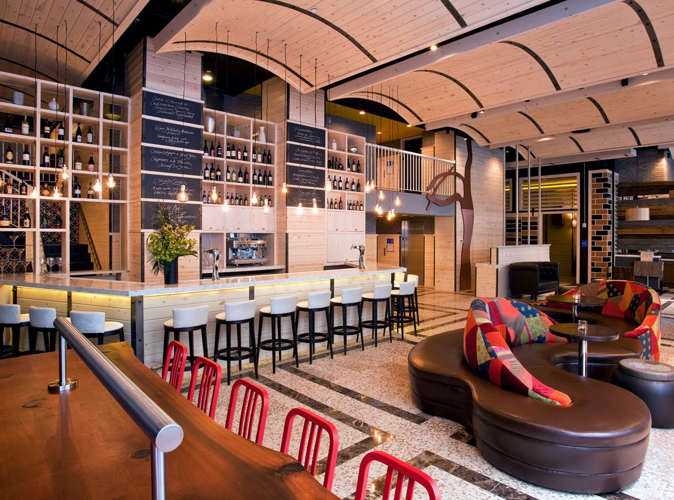 Bar Boutique Hotels Budget Classic Drink Family Family Travel Hotels Living Lobby Lounge indoor floor chair room interior design estate library home restaurant Design Resort living room furniture