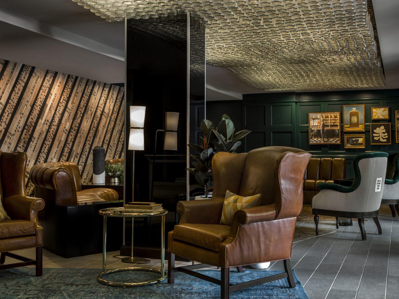 Hotels floor Living room indoor sofa chair living room property furniture Lobby ceiling interior design home Design condominium estate area window covering leather several