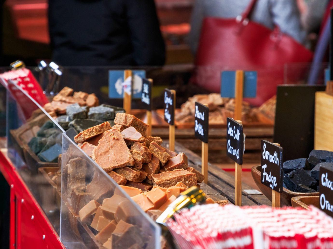 Budget Food + Drink table indoor red City public space food market vendor fair dessert sense