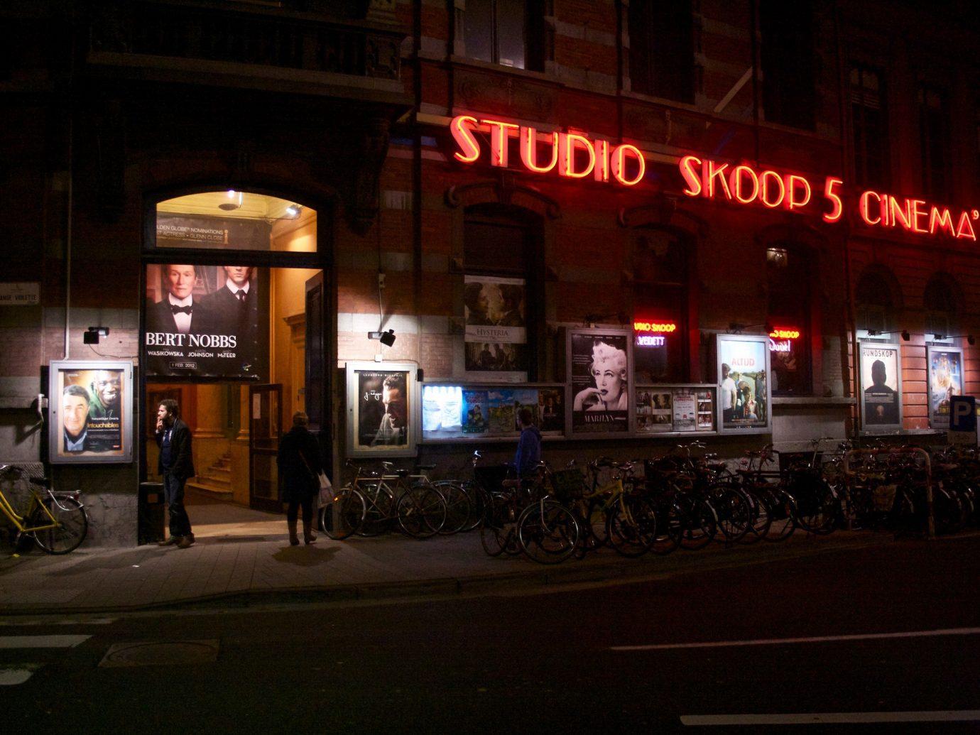 Arts + Culture Trip Ideas outdoor road night Bar restaurant evening lit