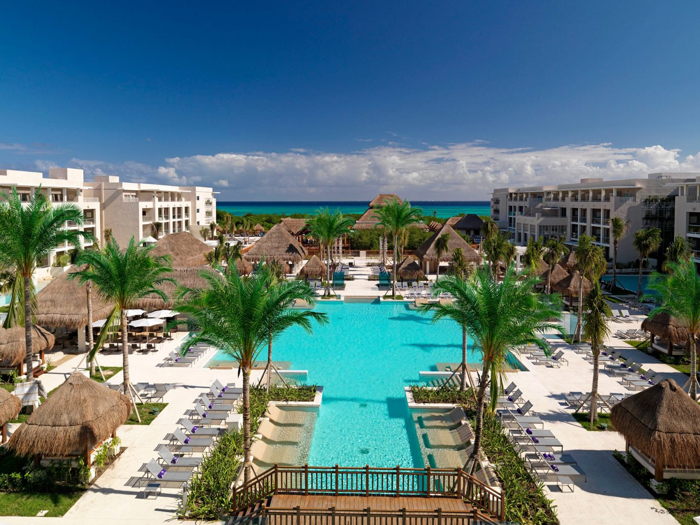 Grounds Hotels Island Pool outdoor building sky Resort leisure property swimming pool condominium marina vacation estate resort town dock real estate Water park bay Garden several