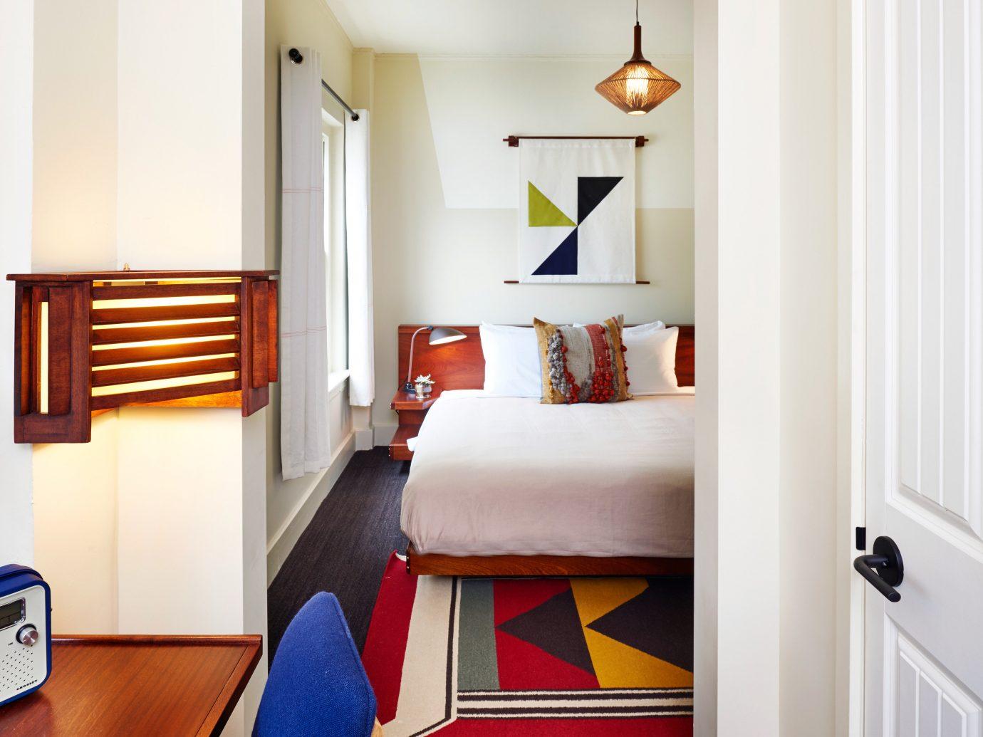 Bedroom Budget Hotels Lounge Suite wall indoor floor room Living property home hardwood interior design living room cottage flooring Design furniture real estate estate apartment area wood