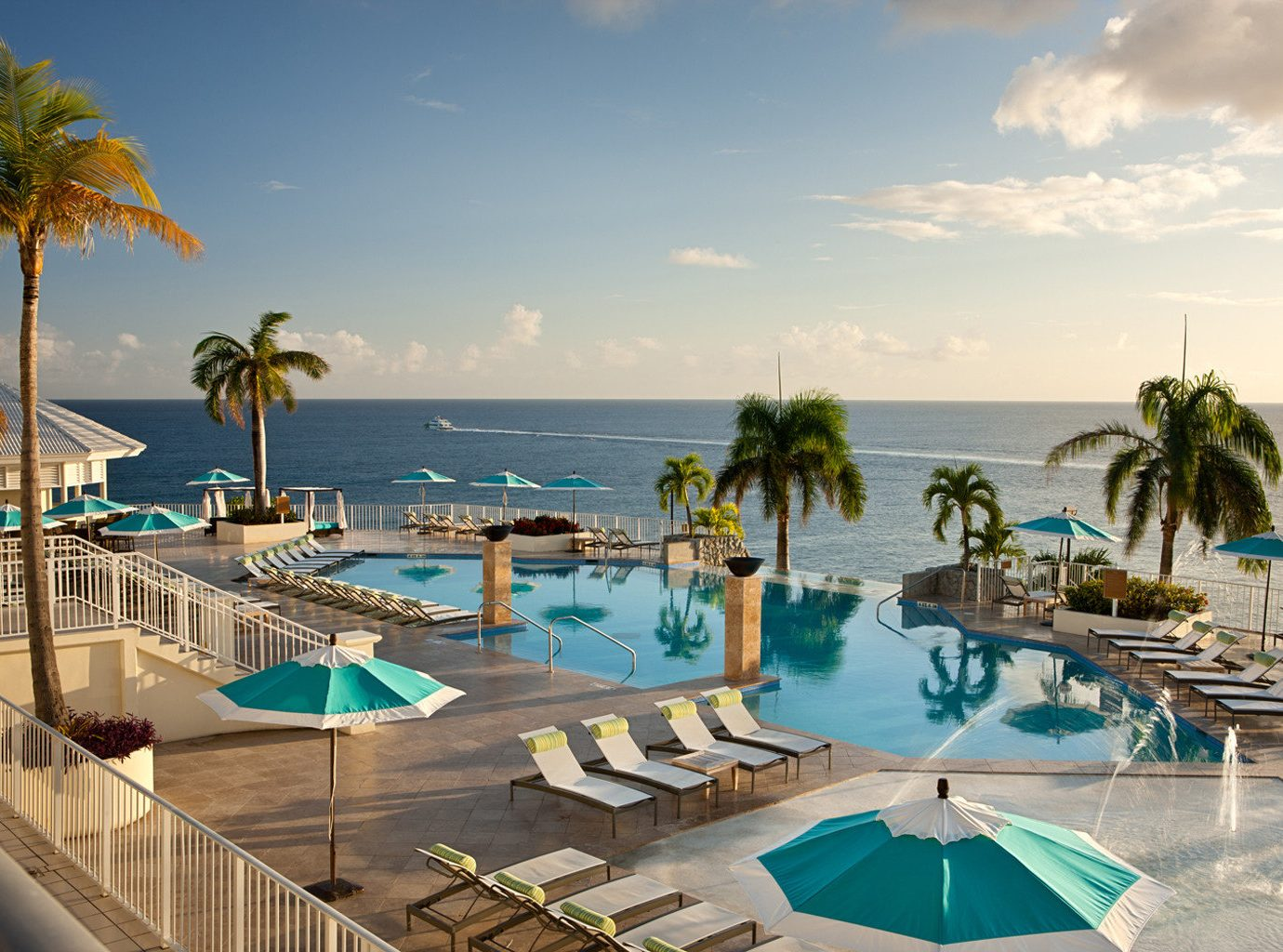 Grounds Honeymoon Hotels Pool Resort Romance Scenic views Trip Ideas Waterfront sky outdoor water umbrella leisure swimming pool caribbean vacation estate Sea palm Beach bay Villa Deck lined shore several