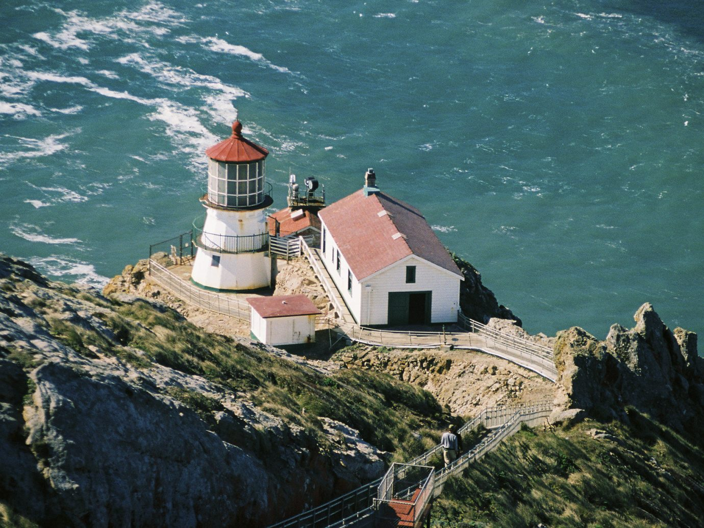 Trip Ideas rock mountain outdoor tower lighthouse Sea Coast Ocean rocky cape cliff terrain aerial photography stone hillside
