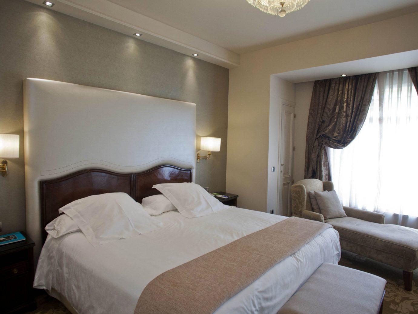 Hotels Madrid Spain bed indoor wall hotel Bedroom room ceiling property Suite interior design real estate cottage estate apartment condominium