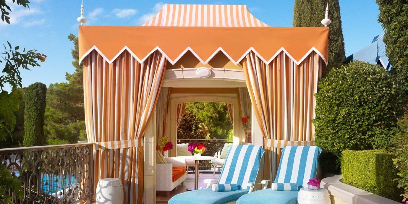 Hotels tree sky outdoor property estate Villa home backyard mansion Resort cottage hacienda furniture