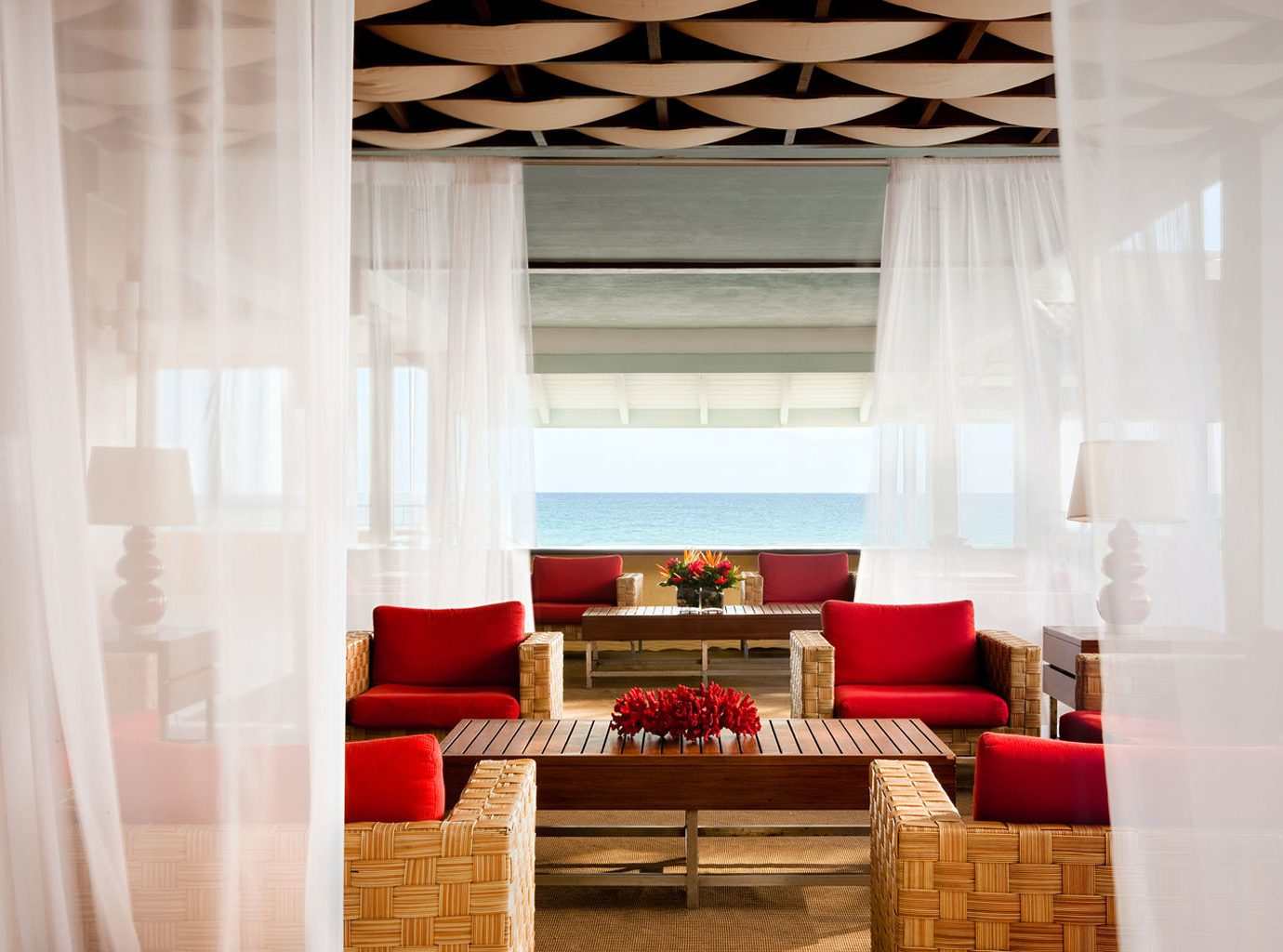 Honeymoon Hotels Lounge Resort Romance Scenic views Trip Ideas Waterfront indoor floor room window living room property curtain interior design red window covering window treatment home white ceiling Design textile Suite decor furniture