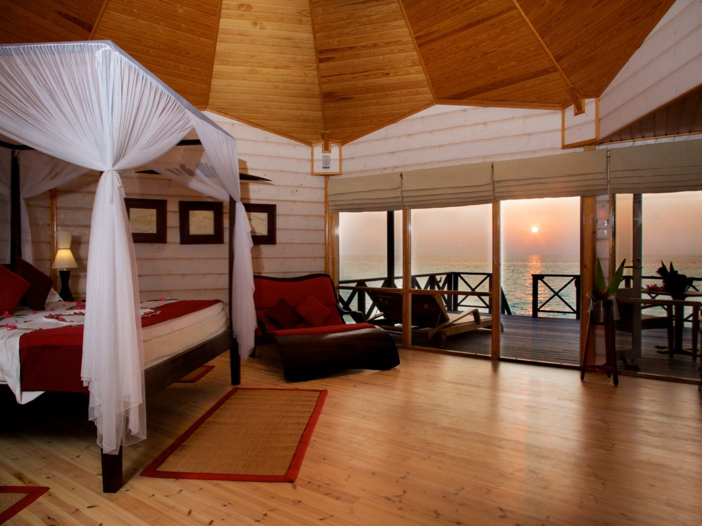 Komandoo Maldives Island Resort Bedroom Overlooking Sunset