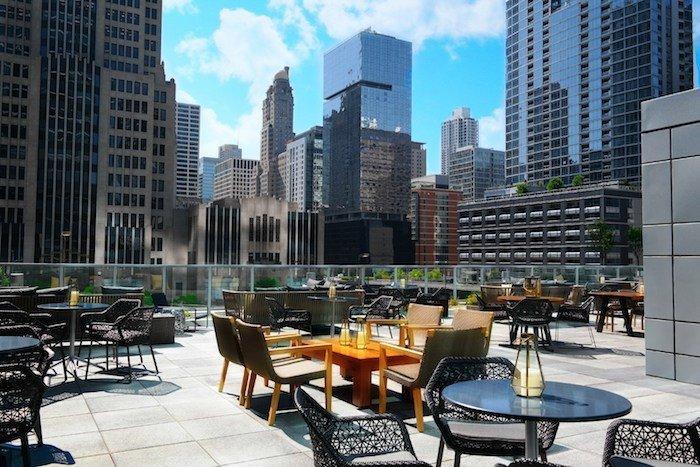 Food + Drink chair outdoor condominium City plaza human settlement Downtown metropolis skyscraper