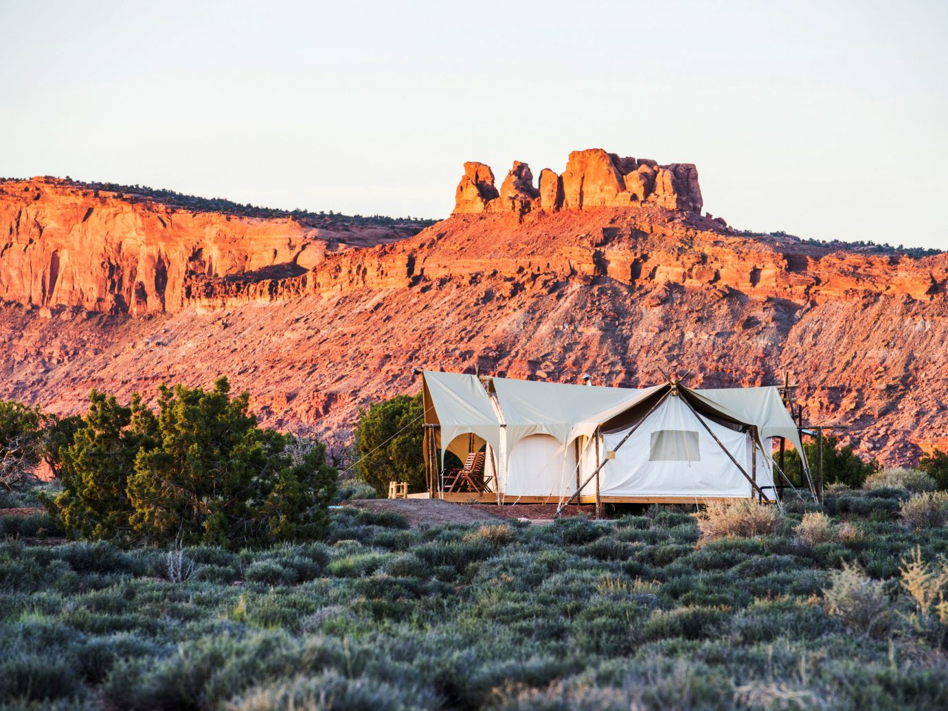 Glamping Luxury Travel Outdoors + Adventure sky outdoor mountain grass canyon valley mountainous landforms wilderness geographical feature natural environment Nature rock season landscape autumn rural area orange plateau mountain range cliff geology national park terrain