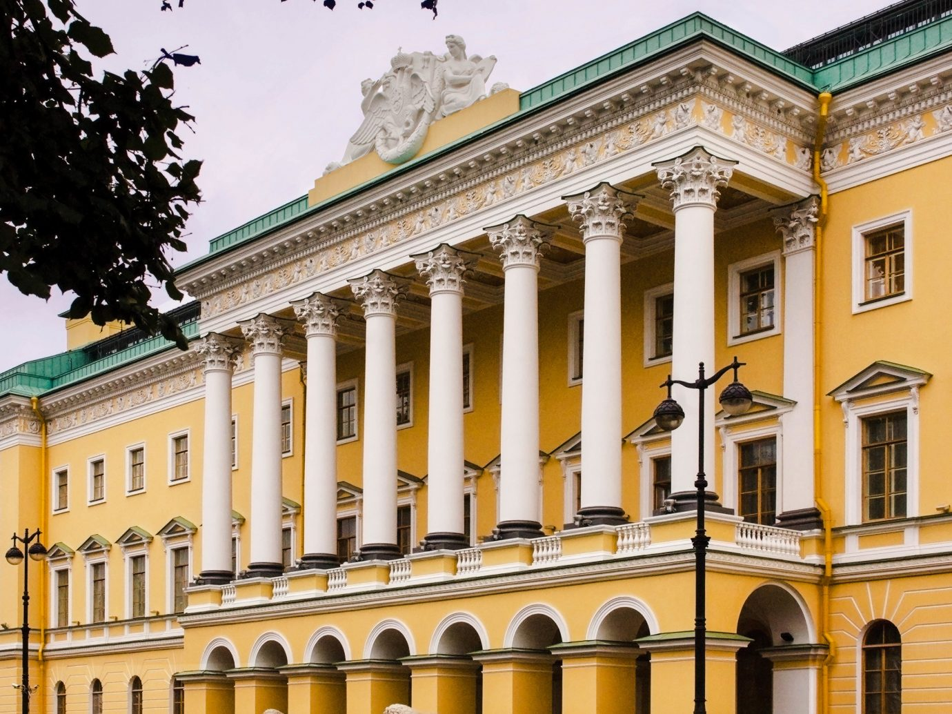 Hotels Luxury Travel outdoor classical architecture landmark building column Architecture structure yellow facade palace château window daytime mansion estate stately home house real estate government building ancient roman architecture historic site symmetry arch arcade historic house stone colonnade