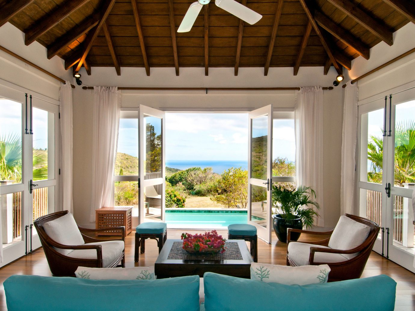 Island Living Luxury Pool Scenic views Trip Ideas indoor window floor room ceiling chair property furniture living room estate Resort home interior design Villa real estate cottage farmhouse porch decorated area several arranged