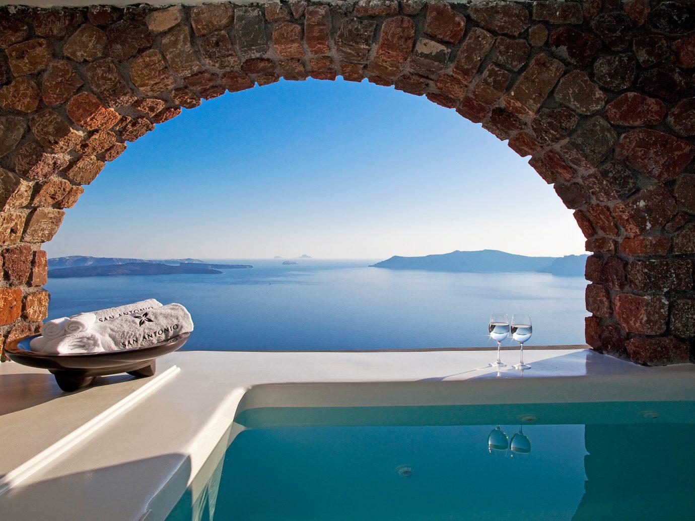 Beach Beachfront Lounge Luxury Modern Ocean Pool Trip Ideas swimming pool building arch estate vacation Villa stone