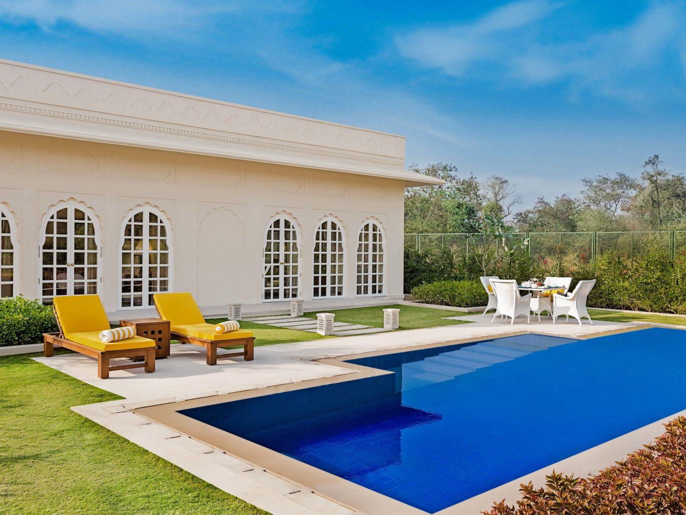 property estate swimming pool Villa real estate leisure home house hacienda Resort backyard facade amenity grass