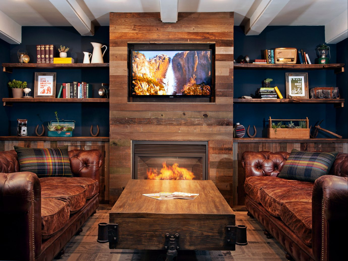 Beach Eco Entertainment Fireplace Glamping Lounge Mountains + Skiing Rustic Trip Ideas indoor Living sofa living room room property hearth home interior design hardwood estate wood recreation room lighting cottage screenshot Design mansion furniture