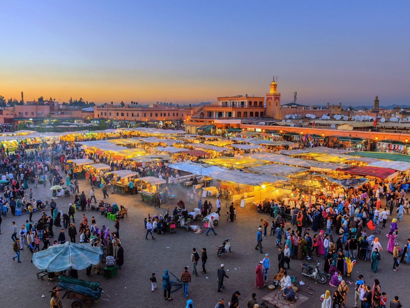 Trip Ideas sky outdoor people crowd person City Town group human settlement tourism cityscape evening many walkway town square line several