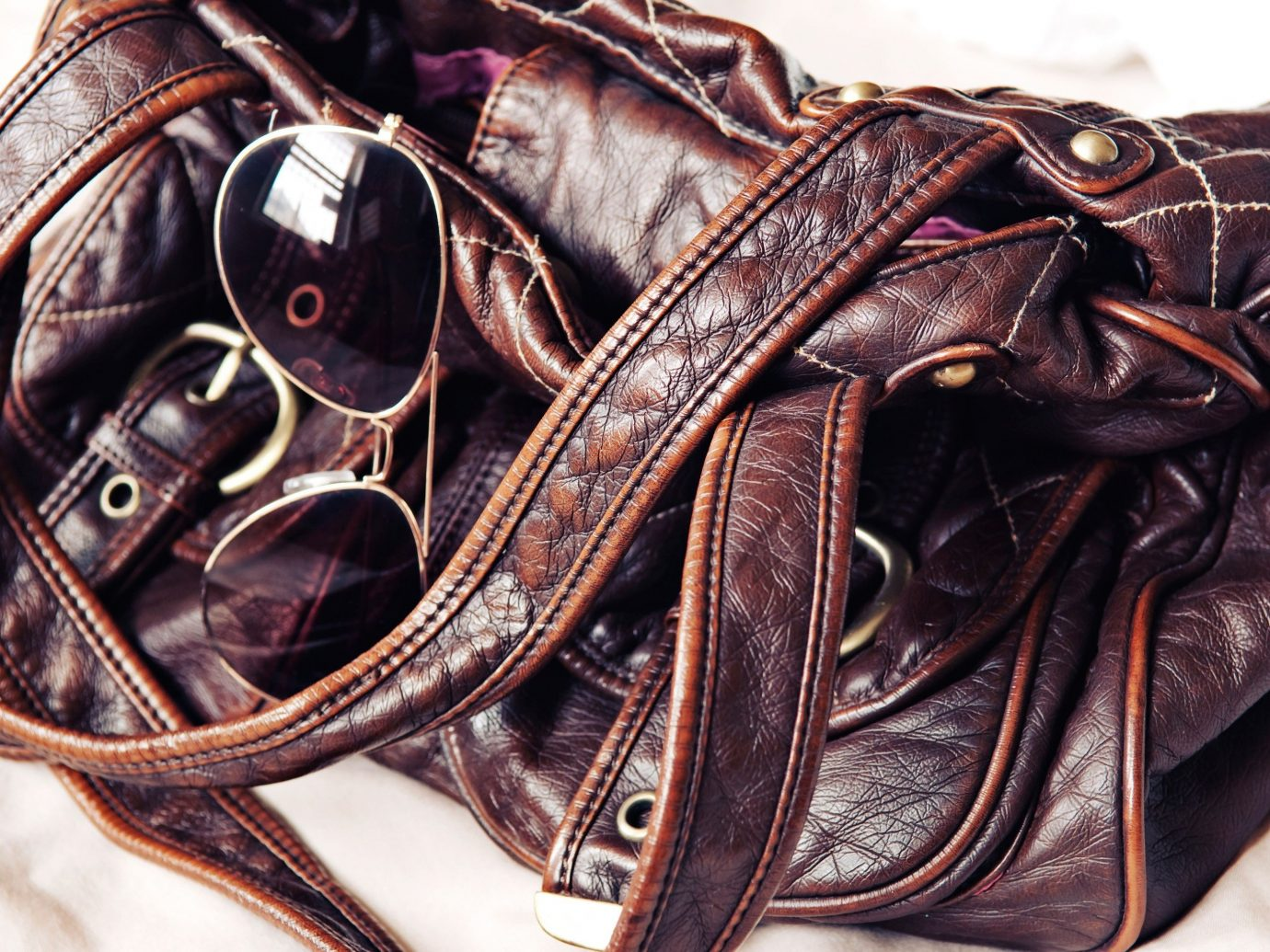 Style + Design handbag bag leather brown shoes fashion accessory footwear bridle textile horse tack material rein feet