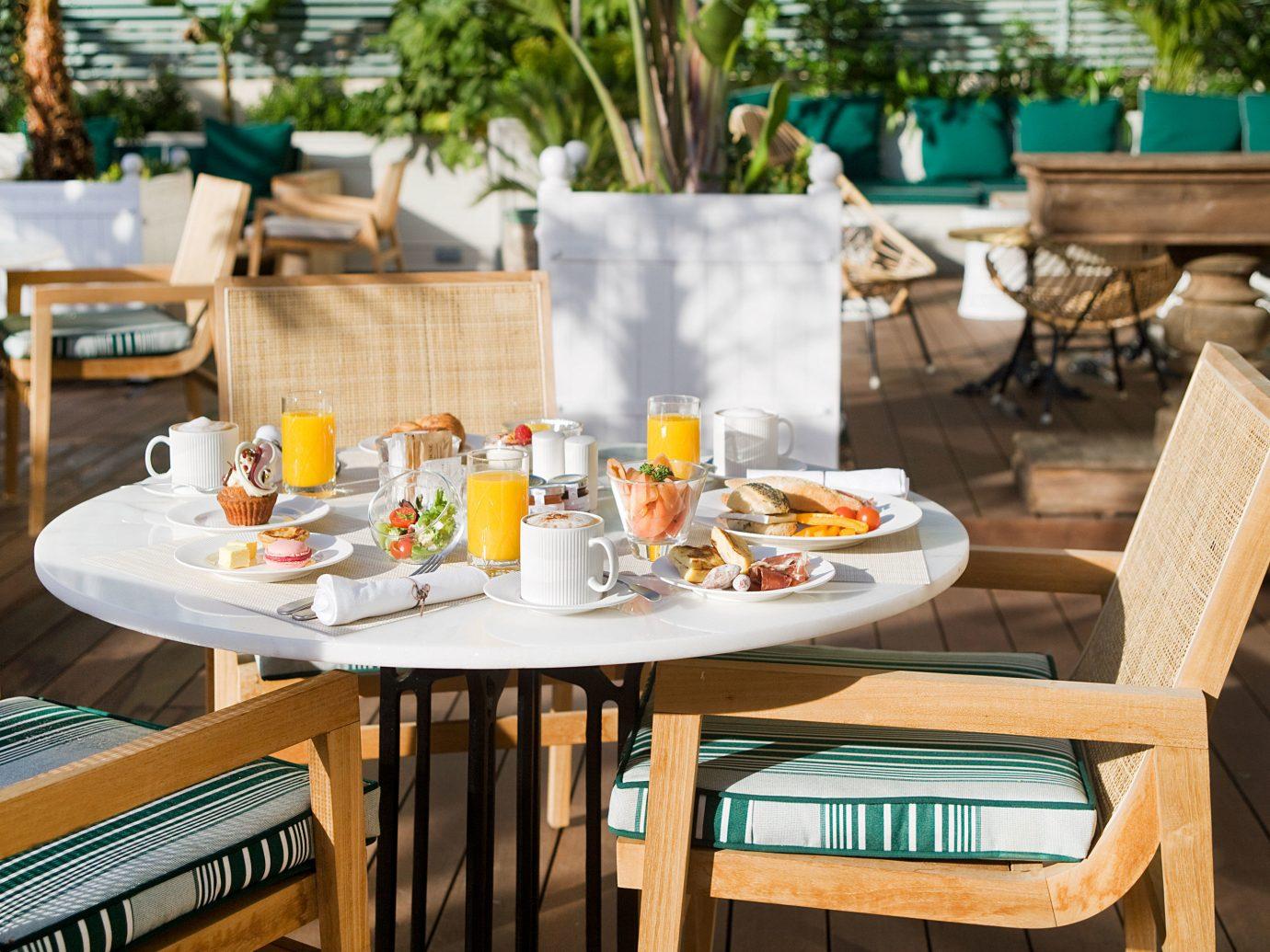 Boutique Hotels Hotels table room restaurant meal Dining brunch lunch interior design Resort dining table