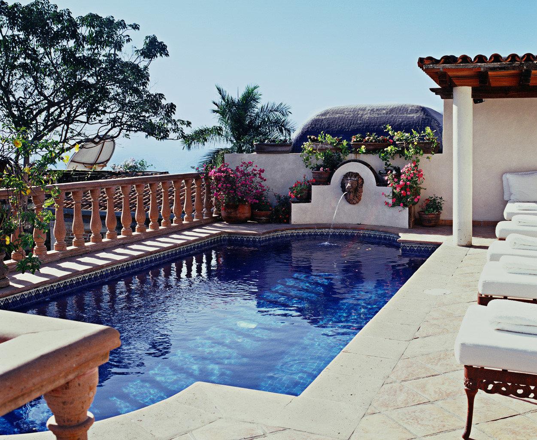 Elegant Hotels Pool Romance Romantic Waterfront tree sky table outdoor swimming pool property leisure estate vacation backyard Villa home Resort hacienda mansion furniture several
