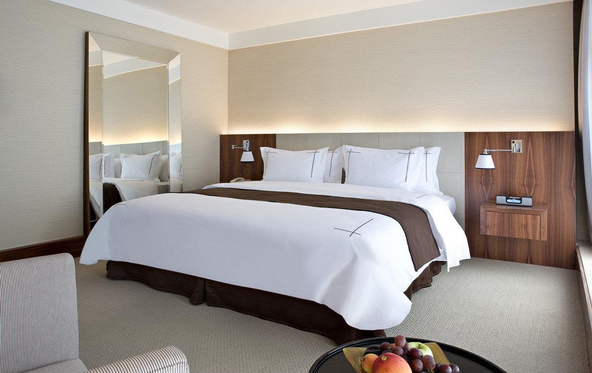 Hotels indoor bed wall hotel room Suite Bedroom bed frame interior design ceiling real estate bed sheet floor window comfort