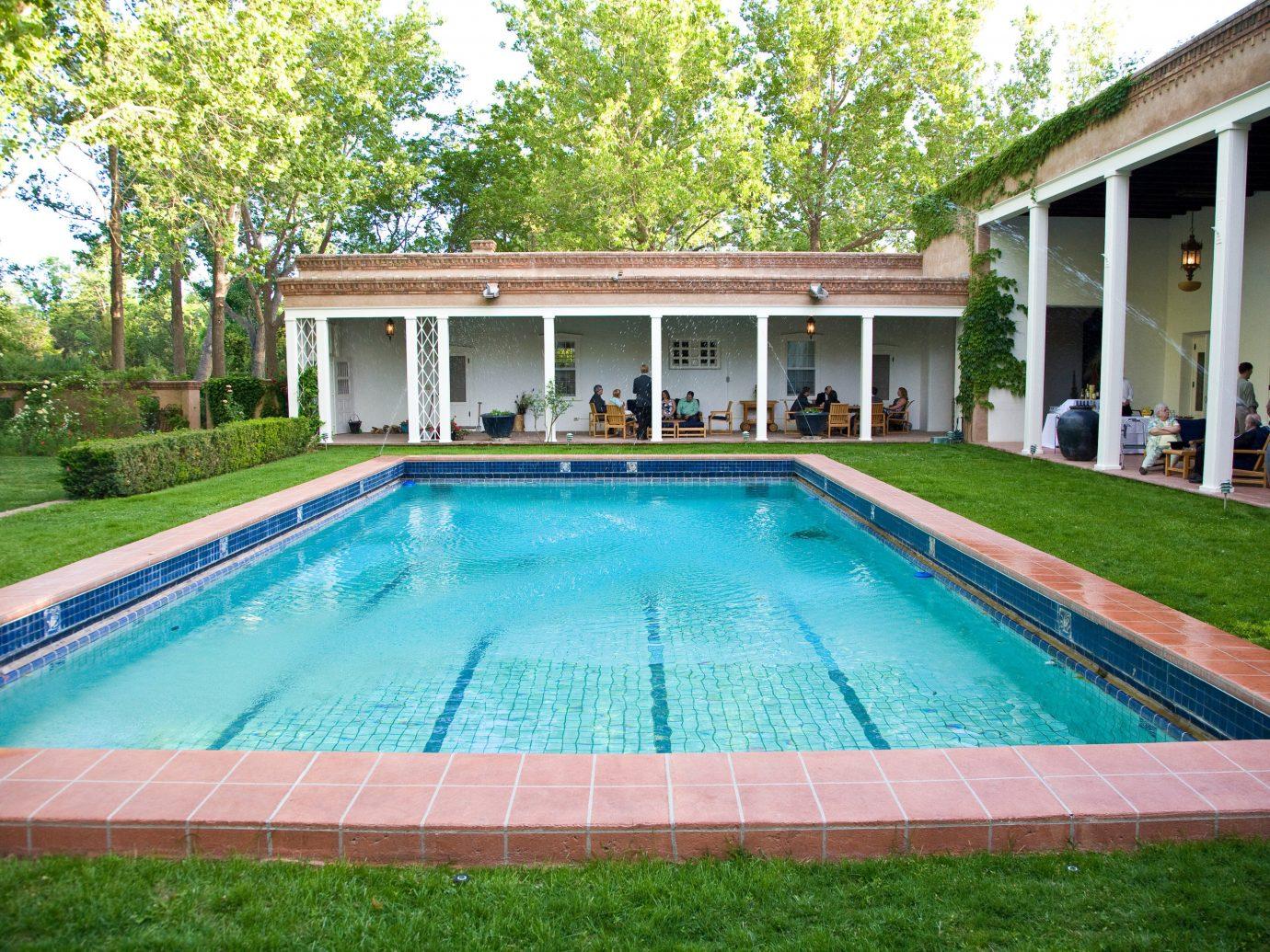 Hotels outdoor building tree grass swimming pool Pool property leisure estate backyard Villa real estate lawn mansion Resort blue Garden