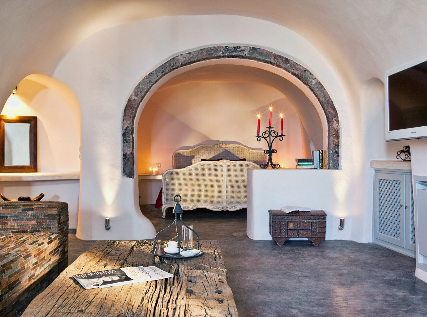 Bedroom Classic Elegant Hotels Island Rustic Suite Trip Ideas indoor wall Living room floor property living room estate Fireplace furniture home hearth interior design cottage Villa real estate farmhouse arch stone wood