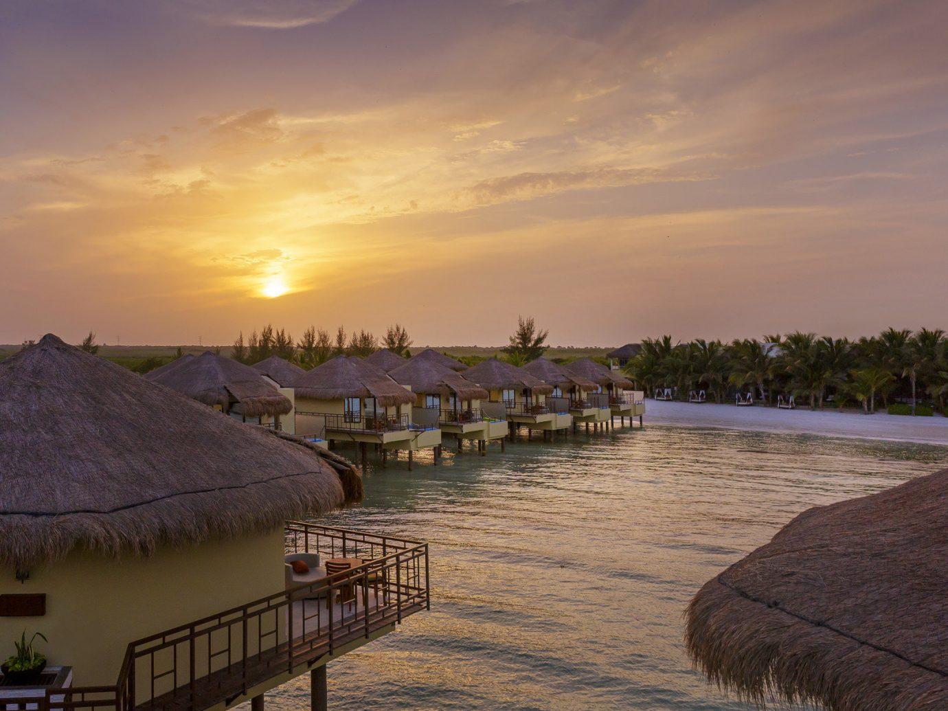 Hotels sky outdoor water shore Sea Sunset morning vacation Beach Ocean evening Coast dusk River dawn bay sunrise