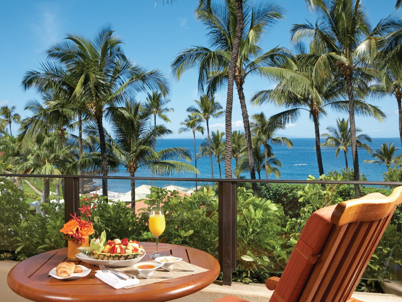 Balcony Hotels Island Lounge Patio Romance Scenic views Terrace Tropical tree outdoor sky property Resort vacation caribbean plant estate arecales palm home Villa Beach palm family real estate swimming pool tropics area furniture