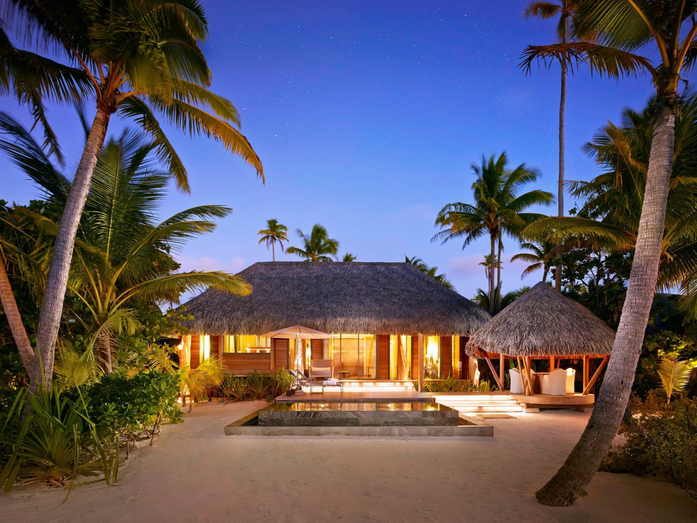 All-Inclusive Resorts ambient lighting Exterior Greenery Hotels huts isolation Luxury Travel night night lights palm trees Pool private private pool remote serene Tropical tree outdoor sky palm plant property Resort estate vacation house home arecales real estate Villa hacienda tropics caribbean mansion area lined