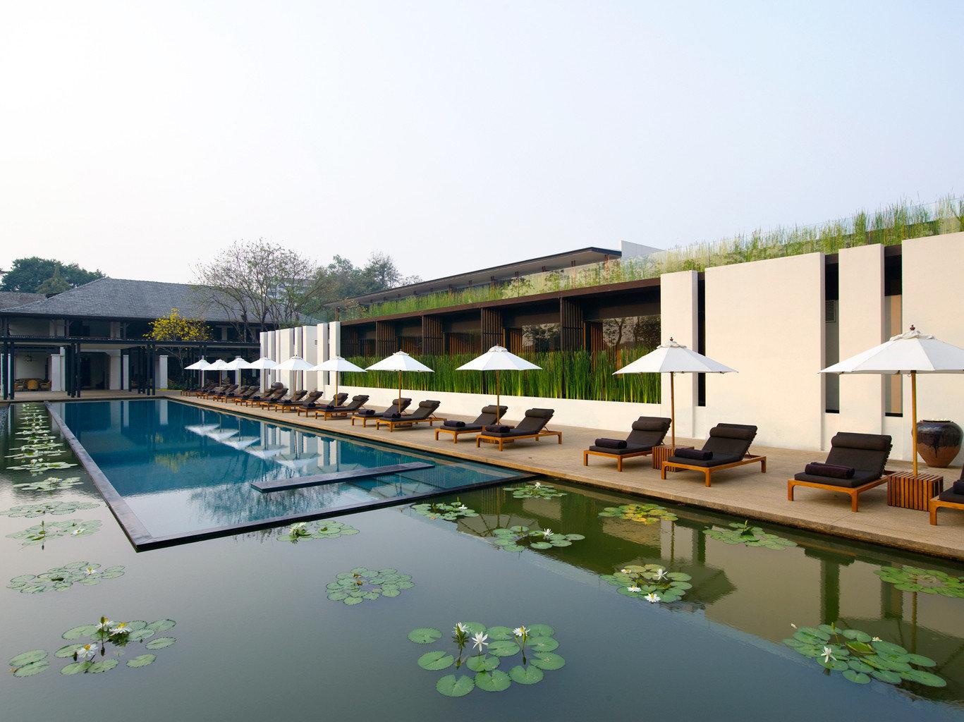 Elegant Hip Hotels Luxury Pool Romance Waterfront sky water swimming pool leisure property outdoor condominium Architecture estate reflecting pool Villa Resort