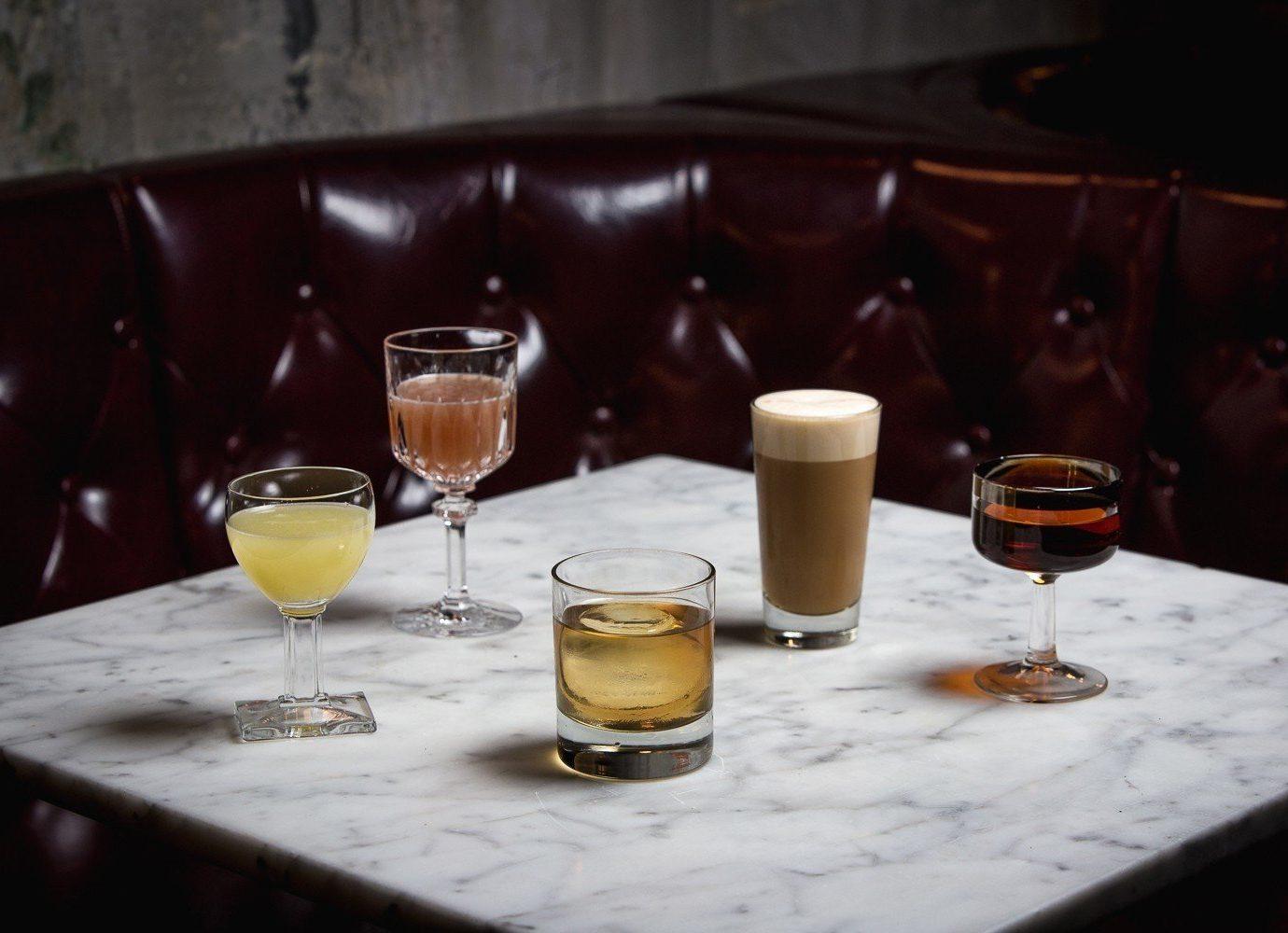 Trip Ideas table wine indoor glass Drink alcoholic beverage distilled beverage lighting meal restaurant Bar drinking