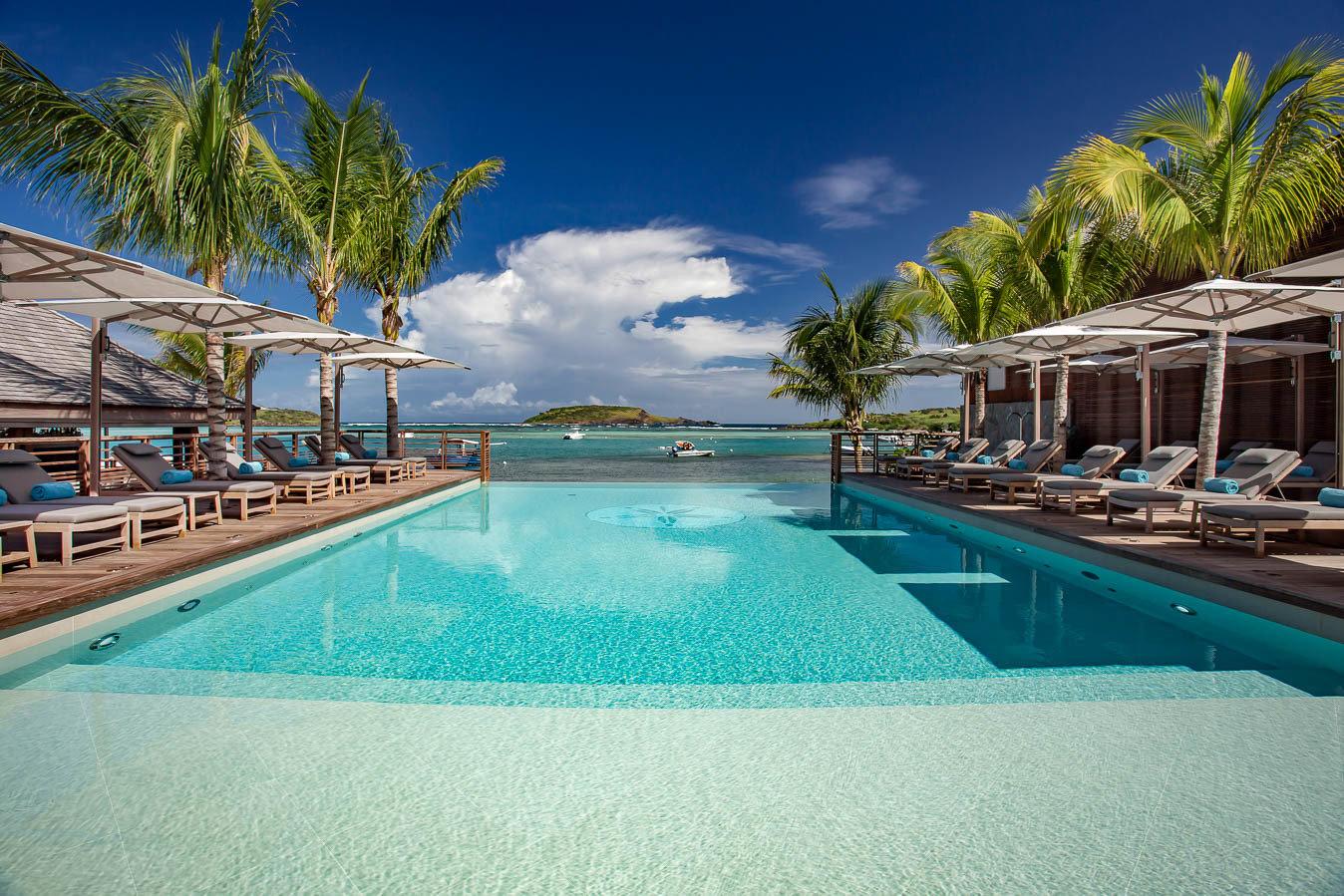 Hotels outdoor tree water swimming pool Pool Resort property leisure vacation estate caribbean resort town Lagoon condominium Villa bay Sea swimming