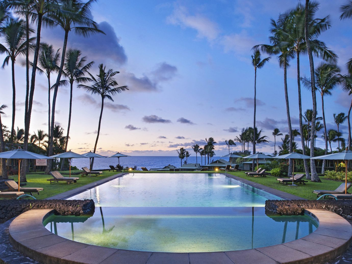 Beach Boutique Hotels dusk Hotels lounge chairs Luxury Luxury Travel Ocean ocean view outdoor pool palm trees Pool remote Sunset Trip Ideas Tropical umbrellas view sky tree outdoor swimming pool leisure property Resort estate vacation Villa palm condominium real estate backyard mansion shore furniture